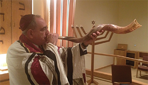 Dr. Block, blowing the shofar.