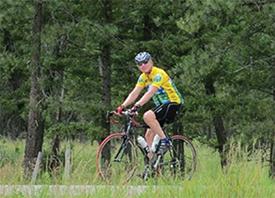 Dr. Weinblatt rides through a forest in Northern Colorado.
