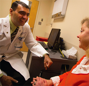 Vikas Majithia, MD, MPH, chats with a patient.