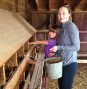 Dr. Kahlenberg and her daughter, Emerson, collecting eggs. They get 80 every day.