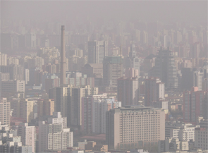 The effects of pollution (such as that shown here in Beijing, China) do not appear until later in the RA disease process.