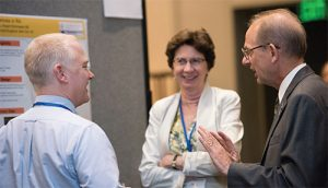 Jon Giles, MD; Joan Bathon, MD; and Foundation President Eric Matteson, MD, MPH, discuss Foundation-funded research at the poster reception of the Investigators' Meeting.