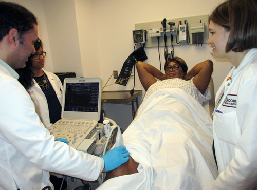 Dr. Beverly Johnson (right) supervising at the Jacobi Ultrasound Clinic with fellows and a patient.