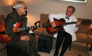 Dr.Schenk with jazz guitarist Sid Jacobs at his office open house in 2010.
