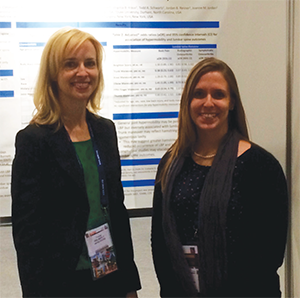 Dr. Golightly presents her work to a colleague, Dr. Alyssa Dufour, at EULAR.