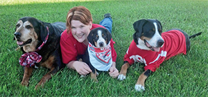 Andrea Christenson with her three service dogs, who help her navigate the world with psoriatic arthritis and adult-onset Still's disease.