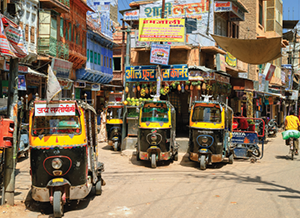 Auto rickshaws, also known as tuk-tuk, waiting for passengers in a daily market. Tuk-tuk is the most popular transport vehicle in India.