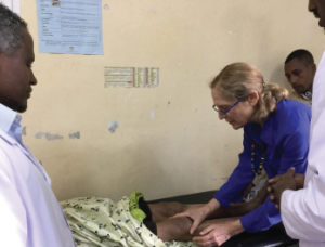 Michele Meltzer teaches physicians how to do joint examination in a rural hospital in Ethiopia.