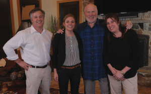 Terry Bradshaw, surrounded by members of the ACR communications team, John Schmidt (left), Erin Schmidt and Joan Roth.