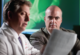 Dr. Alan R. Erickson and Dr. Ted R. Mikuls review data.
