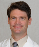 headshot of Angus Worthing, MD, FACR, FACP
