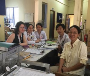 Dr. Seligman (far left) at a Cambodian hospital with other doctors and students.