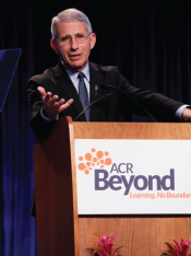 Dr. Anthony Fauci, head of the National Institute of Allergy and Infectious Diseases, addresses attendees in San Diego during the keynote presentation.