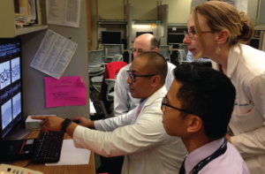 Dr. Lawrence Ho (pulmonary/ILD) points out important features of an HRCT scan to Dr. Greg Gardner (rheumatology), Dr. Percy Balderia (rheumatology fellow) and Dr. Bridget Collins (pulmonary ILD).
