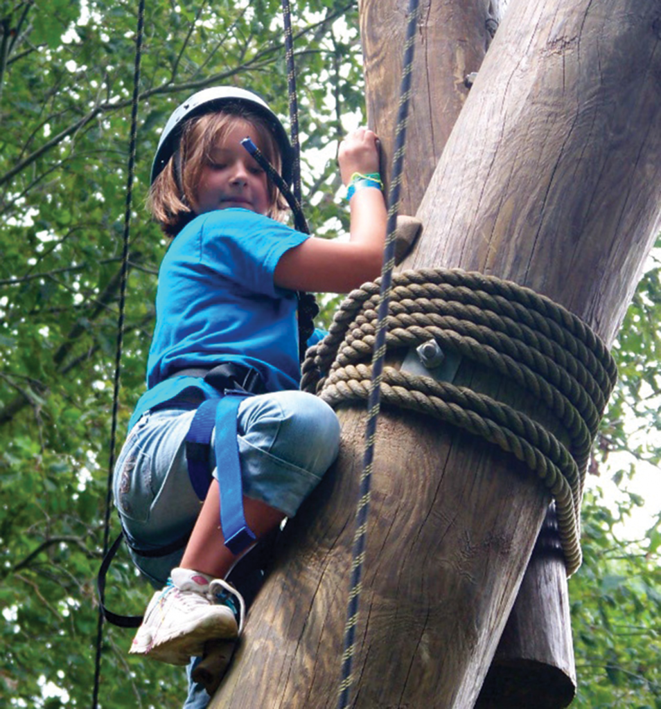 A camper tackles the rope course at Camp Wekandu. Activities are adapted to the campers' ability levels.
