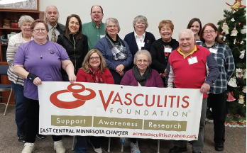Kami Schmidt (seated at lower left) with the East Central Minnesota Vasculitis Support Group in Minnesota.