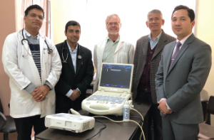 Physicians stand behind the ultrasound Dr. Paul Halverson brought to Patan Hospital, Nepal, for the new rheumatology training program. From left: Drs. Keshav Raj Sigdel, Ujjwal Risal, Paul Halverson, Buddhi Paudyal and Jiwan Poudel.