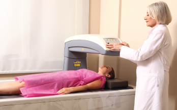 A woman being examined for bone density.