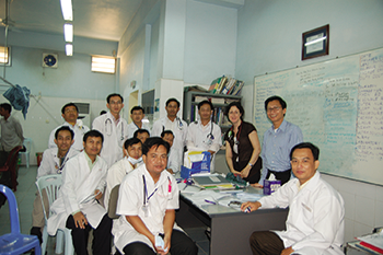 Dr. Seligman (black shirt) teaches trainees in the hospital's emergency department in 2007.
