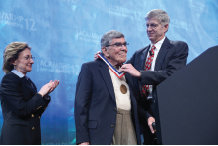Audrey Uknis, MD, and James O'Dell, MD, present Herbert Kaplan, MD, with the Presidential Gold Medal in 2012.