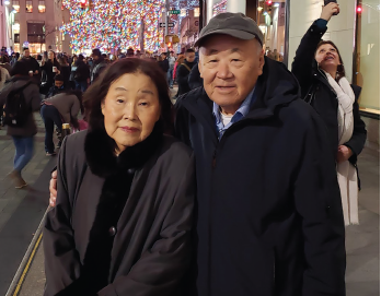 Hae Ja Yoon and Kyung Hwa Seo, the author's parents, at Rockefeller Center, Christmas 2019.