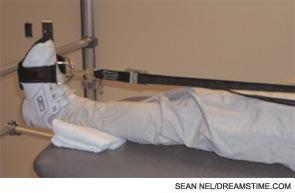 FIGURE 1: This fixed dynamometer has a plinth that allows for easy patient access and non-elastic straps attached to a frame to provide stabilization during strength testing.