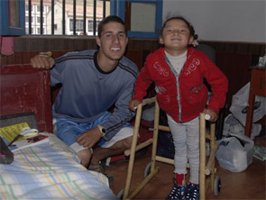 Ariel Bacharach and a Tibetan girl who received one of the walkers he built.