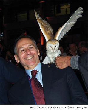 Dr. Pisetsky is visited by an owl, held by one of the Harry Potter character actors.