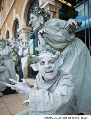 Performers in costume greet EULAR attendees outside of the ExCel convention center in London.