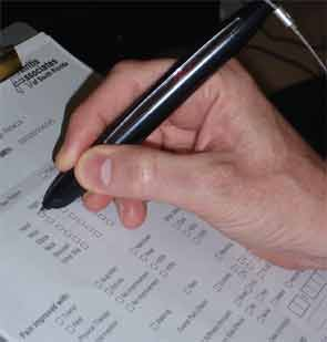 Patients fill out familiar forms with the NextPen, which digitizes the information.