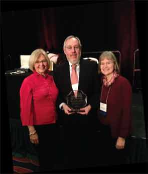 Dr. Hochberg receiving the OARSI Lifetime Achievement Award in 2013, with Drs. Linda Sandell and Virginia Kraus.