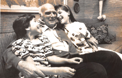 Dr. Edward Rosenbaum with his two granddaughters, Lisa (left) and Jennifer (right).