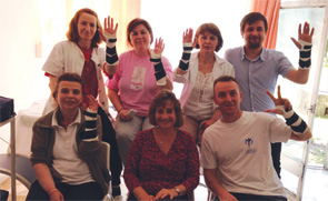 Group picture of therapists in Skopje wearing fabricated wrist orthoses.