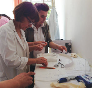 Therapists in a clinic in Skopje learning how to fabricate wrist orthoses.