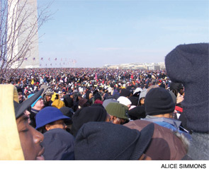 A confetti of Americans watches the inauguration of President Obama.