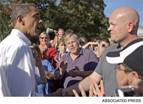 Joe the Plumber asks Barack Obama a question about taxes during a campaign stop.