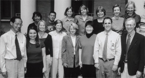 Dr. Liang (at left) with one of his research teams.