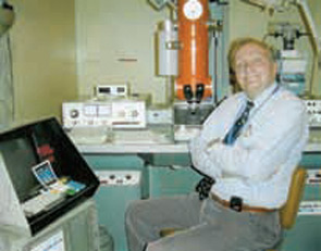 Dr. Schumacher with his electron microscope.