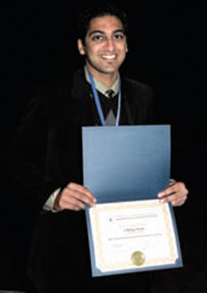 Chirag Vora, MS, receiving his 2009 ACR REF/Abbott Medical Student Clinical Preceptorship certificate at the ACR/ARHP Annual Scientific Meeting.