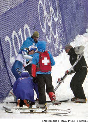Lindsey Vonn is helped by medics and coaches after crashing during the Women's Vancouver 2010 Winter Olympics giant slalom event.