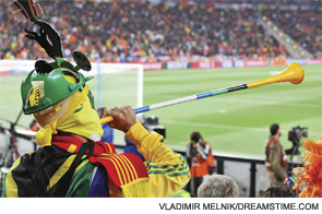 A sports fan supporting his soccer team (or perhaps his Rheumatology World Cup team).