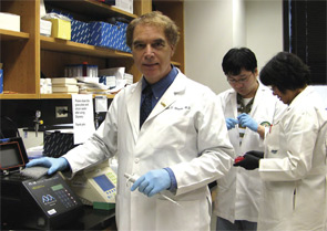 Dr. Mountz (foreground) and colleagues in the University of Alabama research laboratory.