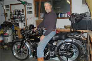 Dr. Rochmis on in his workshop on his 1953 Vincent Black Shadow motorcycle.