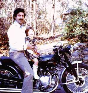 Dr. Rochmis and his daughter on a Vincent motorcycle.
