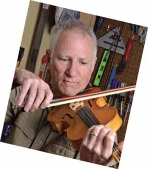 Dr. Higgs playing one of his violins.