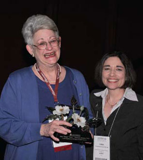 Tyree (left) accepts an Honorary lifetime aRHP membership from Linda Ehrlich-Jones, Phd, Rn, the 2009-2010 aRHP president.