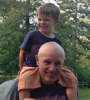 Dr. Atkinson with his grandson, Jack.